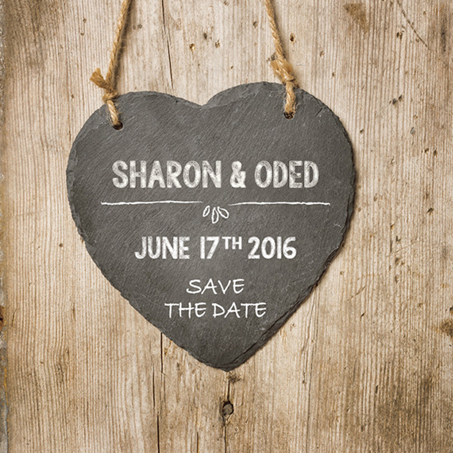 save the date by mili and sara chalk on wood